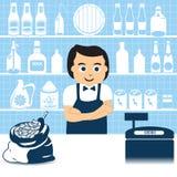Verkäufer im Lebensmittelgeschäft Stockbild