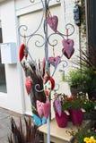 Verkauf der Feiertagsverzierungen im Blumensystem Stockfoto