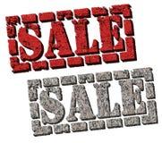 Verkauf (Felsen- und Ziegelsteinverkaufszeichen) Stockbilder