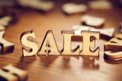 Verkaufsholzwort lizenzfreie stockbilder
