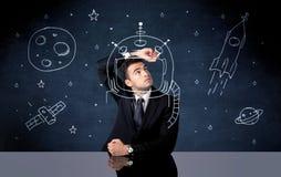 Verkaufspersonenzeichnungssturzhelm und -Weltraumrakete Lizenzfreies Stockbild