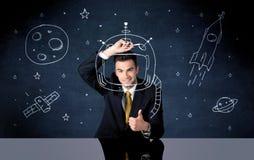 Verkaufspersonenzeichnungssturzhelm und -Weltraumrakete Lizenzfreie Stockfotografie