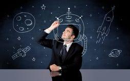 Verkaufspersonenzeichnungssturzhelm und -Weltraumrakete Stockbilder