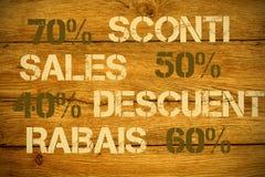 Verkaufsrabatte in den verschiedenen Sprachen lizenzfreie stockfotos