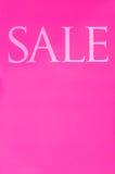 Verkaufszeichen auf einem rosa Hintergrund Stockbilder