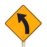 Verkeersteken verlaten kromme die op wit wordt geïsoleerdh Royalty-vrije Stock Foto