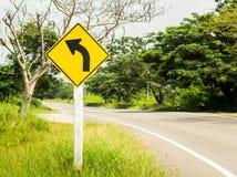 Verkehrsschilder biegen nach links ab Lizenzfreies Stockbild
