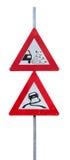 Verkehrsschilder für lose Splitterungen und glatte Straße Stockfotos