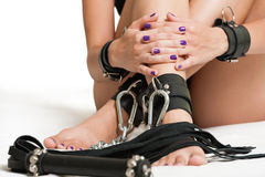 Verkettete Beine und Peitsche Stockfotografie
