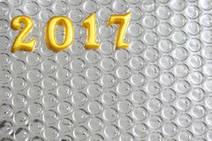2017 verkliga objekt 3d på reflexion omkullkastar, begreppet för det lyckliga nya året Royaltyfri Bild
