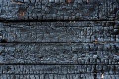 Verkohltes Holz stockbild