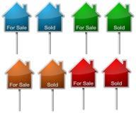 Verkoop en verkochte tekens Stock Foto