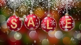 Verkoopbanner op rode Kerstmisballen met ronde sneeuwvlok op gouden bokehachtergrond 4K stock video