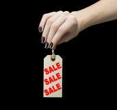 Verkoopmarkering op vrouwenhand Stock Foto's