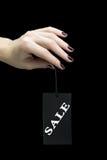 Verkoopmarkering op vrouwenhand Stock Afbeelding
