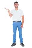 Verkoper die in zijn palm tegen witte achtergrond voorstellen Royalty-vrije Stock Foto's