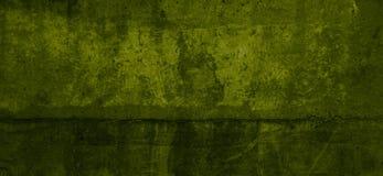 Verkratztes Betonmauerhintergrund-Grüngelb Stockfotos