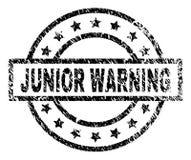 Verkratztes strukturiertes WARNING JuniorStempelsiegel stock abbildung