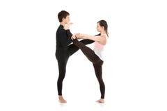 Verlängerte Hand-zu-großzehenhaltung Acro Yoga Lizenzfreie Stockfotografie