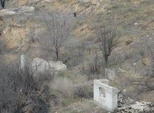 Verlassenes und ruiniertes Dorf Stockfotos