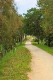 Verlaten grint wandelingsweg stock fotografie