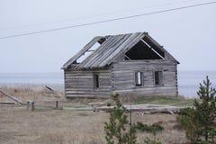 Verlaten huis door het overzees royalty-vrije stock afbeelding