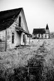 Verlaten huis en kerk royalty-vrije stock foto