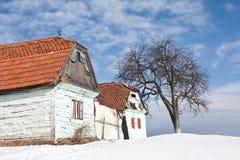 Verlaten huizen in de winter Royalty-vrije Stock Afbeeldingen