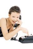Verleidelijk meisje dat bij de telefoon roept Royalty-vrije Stock Afbeelding
