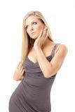 Verleidelijke blonde in een kleding Royalty-vrije Stock Foto's