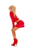 Verleidelijke blonde in rood Stock Afbeeldingen