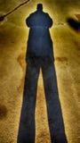 Verlengde mannelijke schaduw stock afbeelding