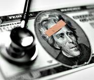 Verletzung des Geldes Stockfoto