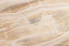 Verlicht plakken marmeren onyx Horizontaal beeld Warme kalme kleuren Mooie dichte omhooggaande achtergrond, onyx marmeren textuur Royalty-vrije Stock Afbeelding