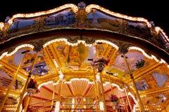 Verlichte carrousel bij nacht Royalty-vrije Stock Foto's