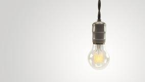 Verlichte 3D teruggegeven wijnoogst lightbulb over een heldere witte achtergrond Stock Afbeeldingen