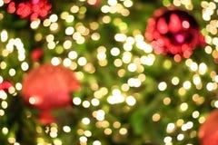 Verlichting vaag bokeh op Kerstboomachtergrond stock afbeeldingen