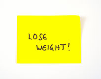 'Verlieren Sie das Gewicht', das auf eine klebrige Anmerkung geschrieben wird Stockbilder