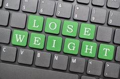 Verlies gewichtssleutel op toetsenbord royalty-vrije stock afbeelding