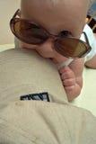 Vermakelijke baby Stock Foto's