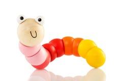 Verme di legno del giocattolo del bambino isolato su bianco Fotografie Stock