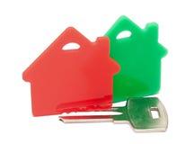Vermelho com casas verdes e chave Fotografia de Stock Royalty Free