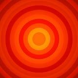 Vermelho concêntrico e a laranja circundam o fundo Foto de Stock Royalty Free