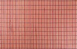 Vermelho de madeira de bambu do fundo Fotos de Stock
