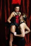 Vermelho do moulin do dançarino dos pares Foto de Stock Royalty Free