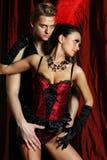 Vermelho do moulin do dançarino dos pares Imagem de Stock Royalty Free
