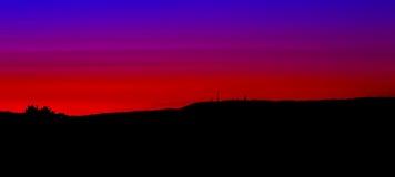 Vermelho e azul do por do sol Fotos de Stock Royalty Free