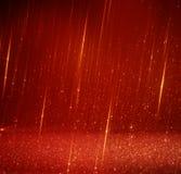 Vermelho e luzes abstratas do bokeh do ouro Fundo Defocused Imagem de Stock