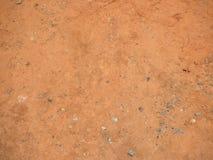 Vermelho e marrom da textura à terra Imagens de Stock Royalty Free