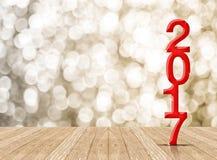 Vermelho um número de madeira de 2017 anos na sala da perspectiva com bok efervescente Fotografia de Stock